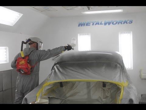 Spraying a two tone paint job on 1954 Chevy by Metalworks Classic Auto Restoration. Car paint.