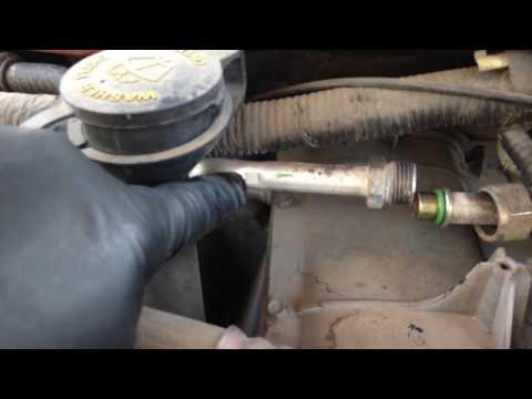 2001 Ford E 250 orifice tube location