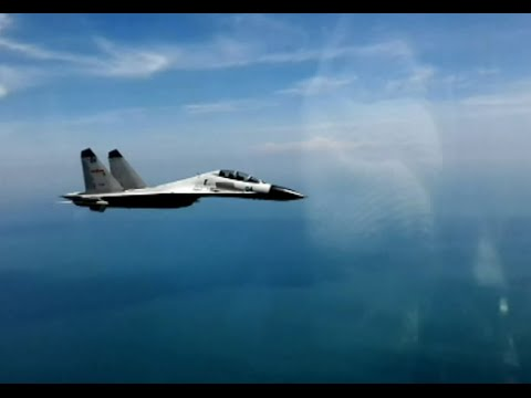 Chinese Naval Air Force Conducts Live Fire Drill over South China Sea