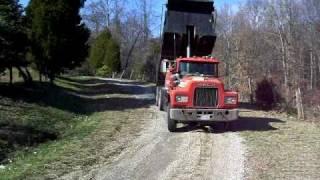 Mack R Model spreading gravel