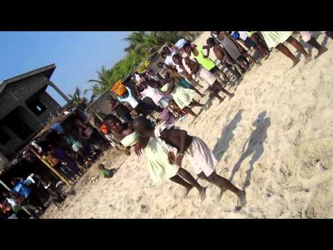 West African Kids Dancing and Drumming on the beach in Ghana