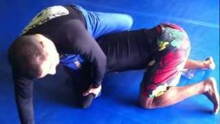 Roger Machado demonstrates Single Leg to Arm bar technique