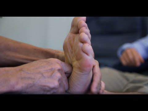 Jonathan Legg gets a foot reflexology session in a Thai massage school