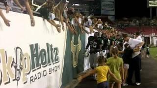 USF players high-five fans after beating Florida Atlantic