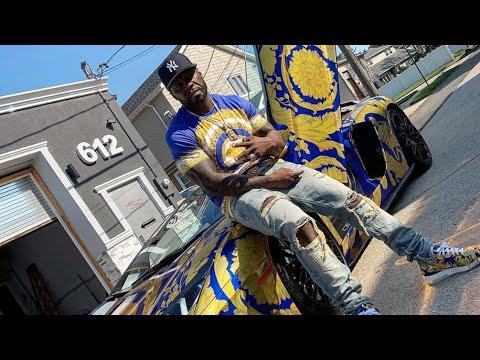 50 Cent Buys Versace Lamborghini To Match His Shoe Drip