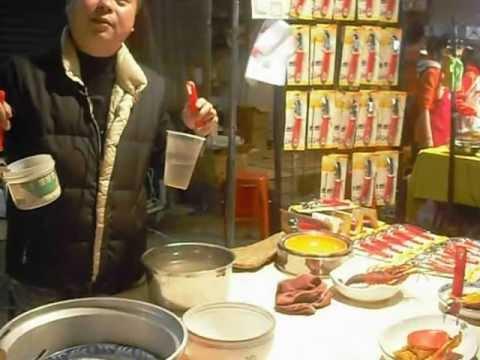 Chinese New Year 2013, Market Gathering, Demo of a Dish Picking Tool. Merry Making, Sanshia, Taiwan.