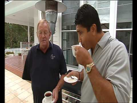 Mario Fenech gives One armed man a Cup and Saucer.