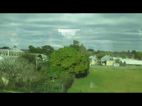 Brisbane CoffsHarbor by train and bus. John Coyle video.