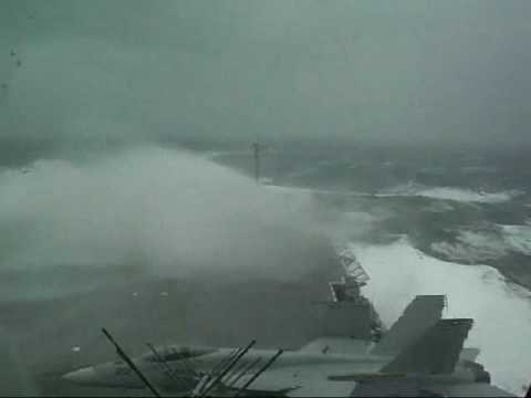 CV63 aircraft carrier in storm