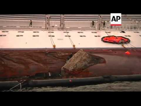 Firefighters continue search of cruise ship; European Union mission arrives