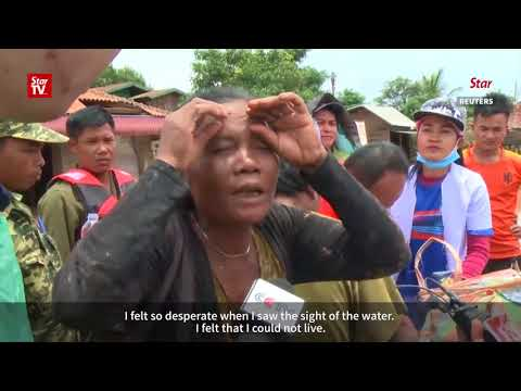 Scramble for food and medicine after dam burst in Laos