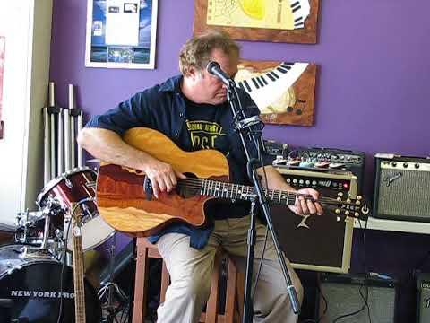 Steve Arvey Demo's A Acoustic Luna Guitar At The Vibe Music Store Apollo Beach Florida