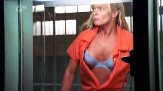 Jaime Pressly flashes her bra