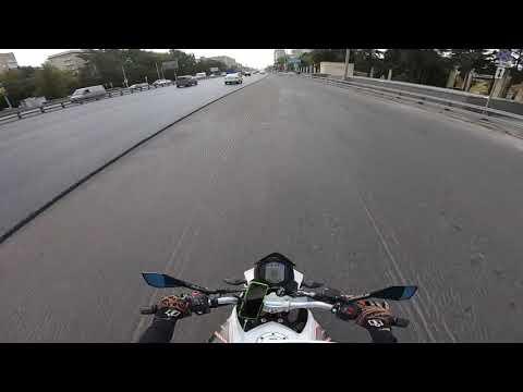 Снятый асфальт, мотоциклистка и грузовик