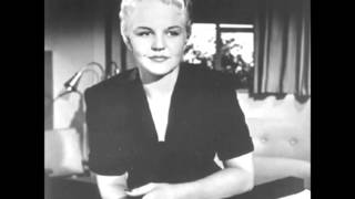 Watch Peggy Lee Sing A Rainbow video
