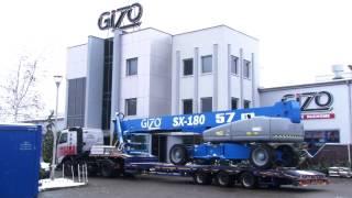 Gizo podnośnik Genie SX180 - 57m załadunek, transport i rozładunek maszyny