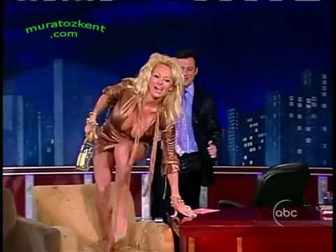 Pamela Anderson on TV show with super sexy dress jump ! thumbnail