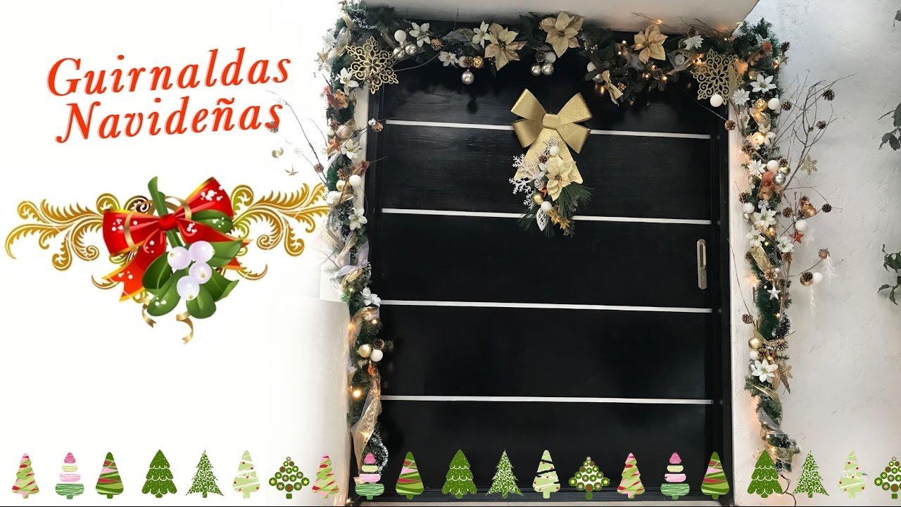 Guirnaldas navide as decoraci n de puerta navide a for Guirnaldas para puertas navidenas