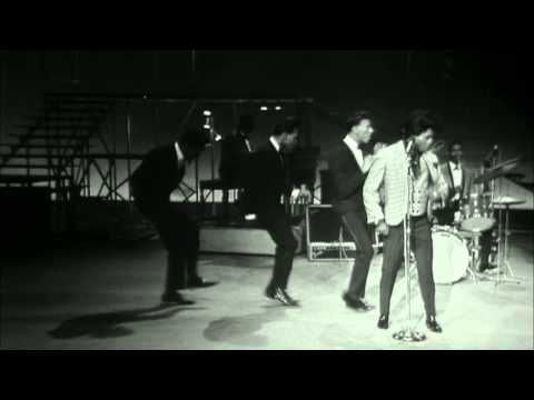 James Brown performs and dances to