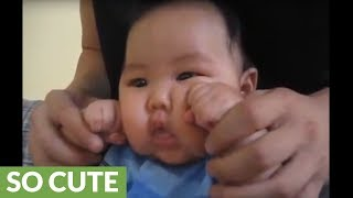 Super cute baby works out with his uncle