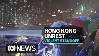 Hong Kong protesters try to break out of besieged university | ABC News