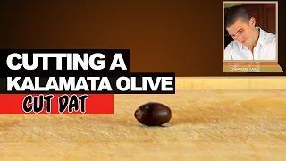 Cutting a Kalamata Olive