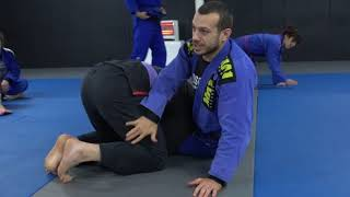 Defending the rugby pass using wrestling techniques