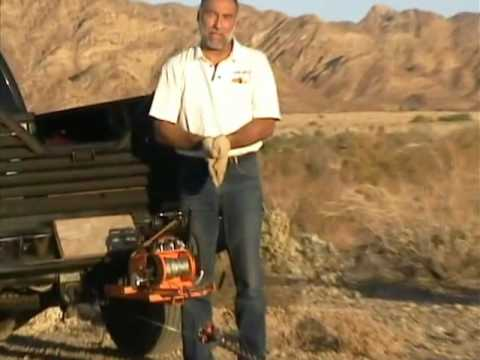 Lewis Winch snatch block demo, huge log skid. Double the pulling power of a portable winch.