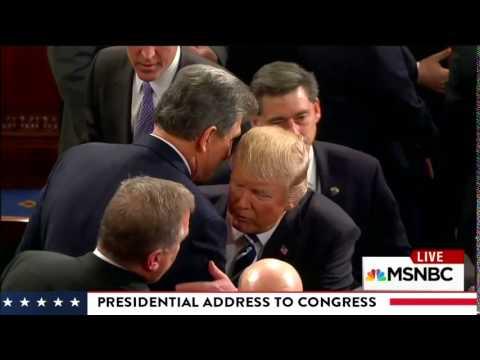 President Trump gives Sen. Joe Manchin a hug