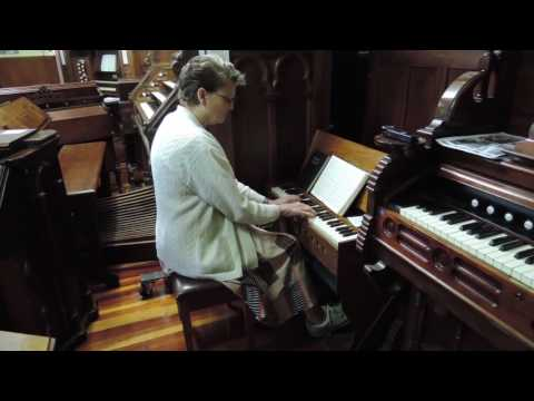 Rosalie Wainwright plays a portable pedal reed organ.