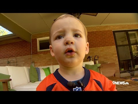 This 2-year-old can name Denver Broncos players by their cards