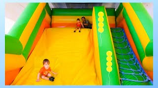 Trampoline fun. Kids jumping on Bouncy Castle