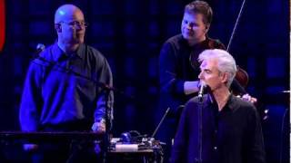 "David Byrne sings ""(Nothing But) Flowers"""