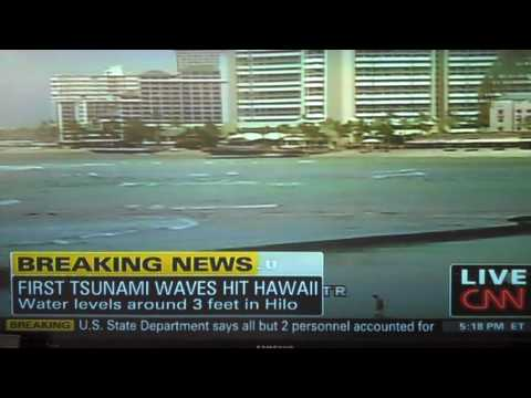 Idiot on the beach during the Tsunami in Hawaii