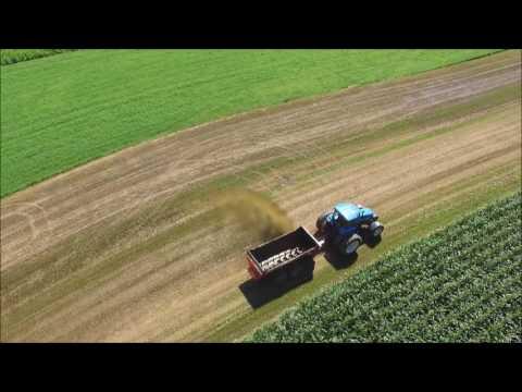 Kuhn Knight Slinger Hauling Liquid Manure on Hay