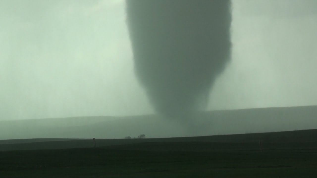 Stunning stovepipe tornado grinds across Colorado landscape