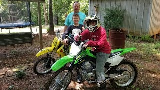 Just riding Dirtbikes in the summer. Kawasaki and Suzuki