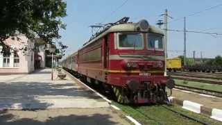 Bulgaria: Lom, BDZ Class 44 electric locomotive leaves Lom station on a passenger service