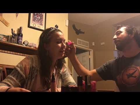 Doing my girlfriends makeup.