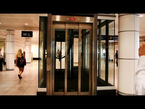 Epic, Priceless & Amazing inground hydraulic glass elevators @ Montreal Trudeau Airport (YUL)