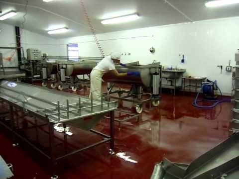 Soft cheese production at  Carol and Simon Weaver Cotswold Organic Dairy, using tipping vats