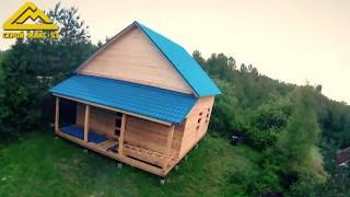 Видео о строительстве брусового дома под усадку
