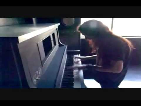 Tuomas Holopainen playing the piano.