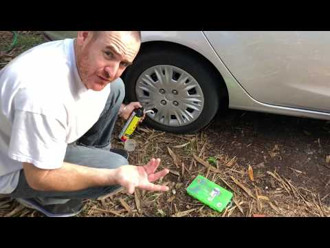how-to-fix-a-flat-tire-that-leaks-air-with-fix-a-flat-foam-sealer.