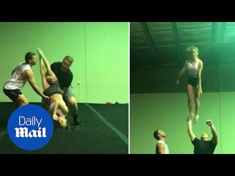 Nice catch! Cheerleader saves flyer before her head hits the ground - Daily Mail