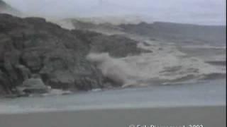 Ilulissat, Greenland - Giant rolling Iceberg creates a tsunami like wave