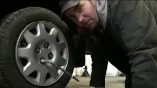 How To Change a Flat Tire Using The Tools In Your Car - EricTheCarGuy