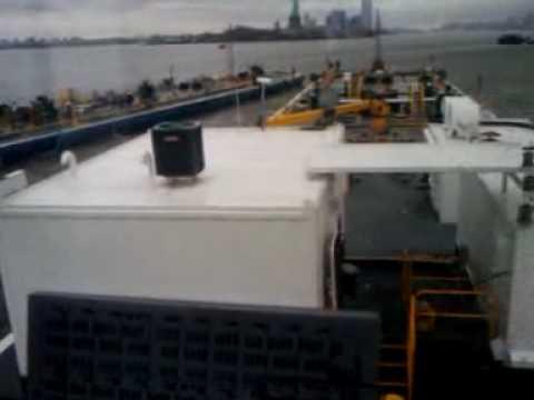 Chris Tranos Landing Oil barge at Mooring.