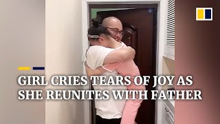 Download Chinese girl cries tears of joy as she reunites with father after 5 months