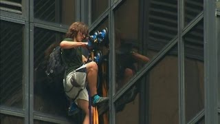Man seen scaling Trump Tower with suction cups